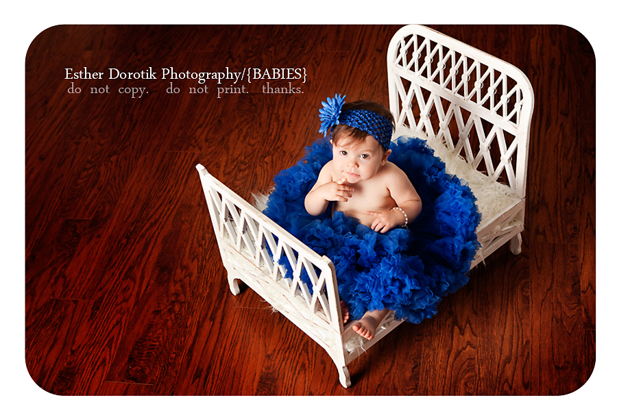 baby-sitting-on-chic-bed-with-blue-petticoat-taken-by-dallas-baby-photographer