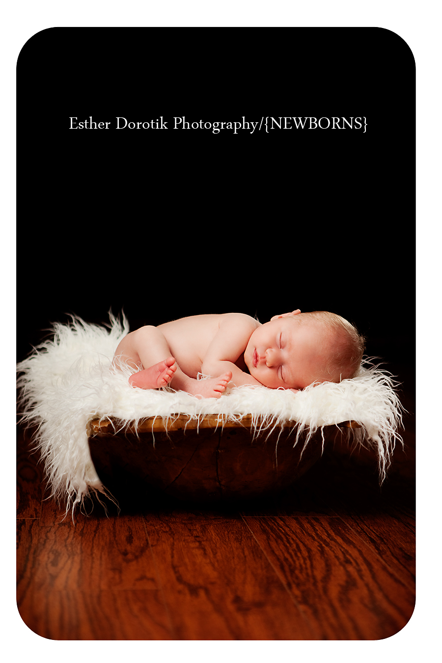 newborn-photograph-of-baby-laying-on-fur-in-basket-dallas