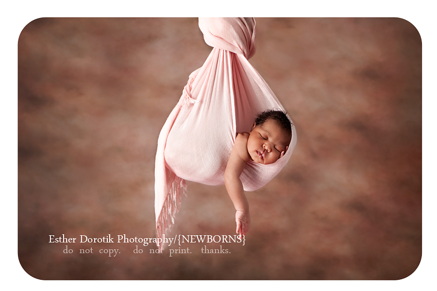 Dallas-photograph-of-7-day-old-newborn-girl-hanging-in-blanket