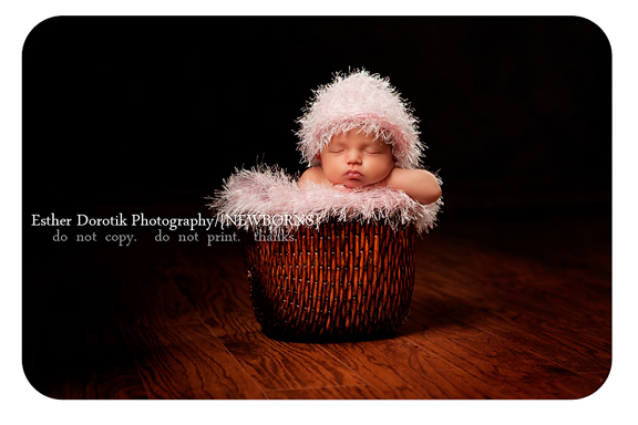 dallas-newborn-photographer-captures-14-day-old-girl-in-basket-with-pink-fuzzy-hat