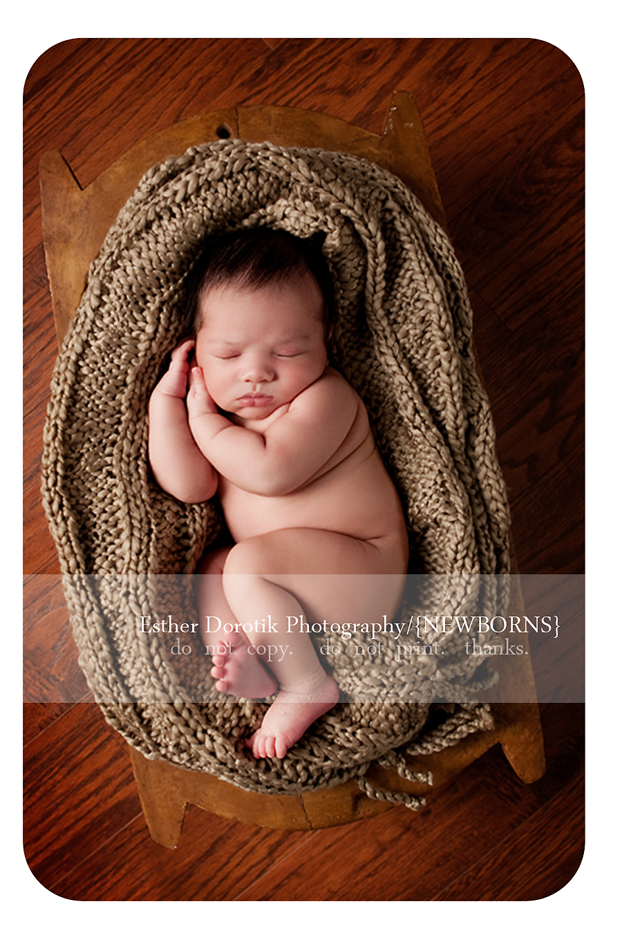 photograph-of-newborn-baby-posing-with-hands-on-face-taken-in-by-Dallas-newborn-photographer