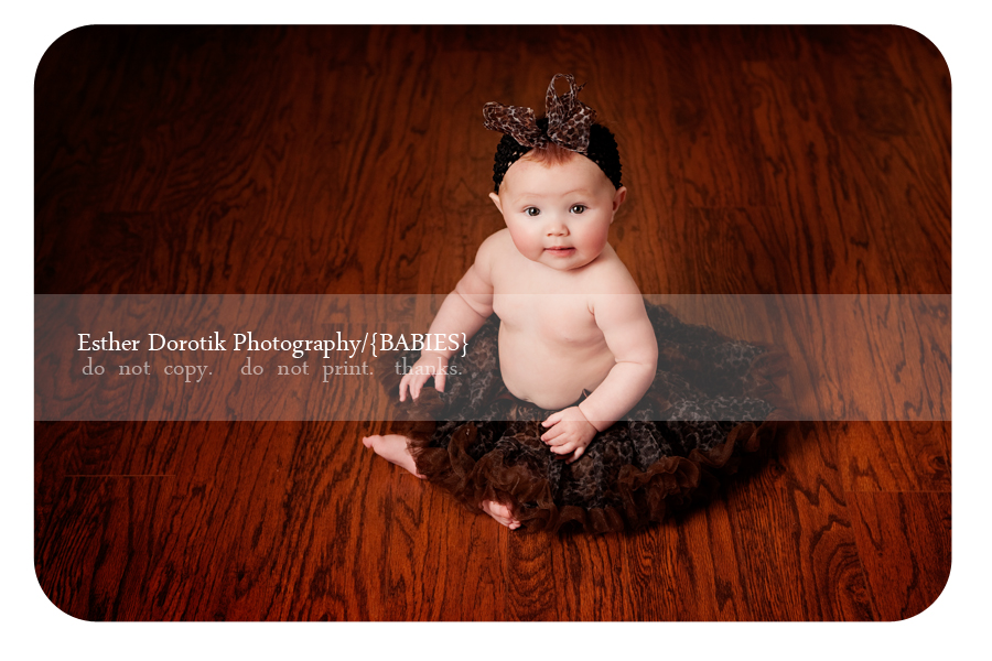 photograph-of-6-month-infant-girl-with-leopard-print-tutu-and-headband