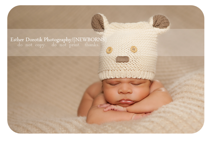 newborn-photo-of-6-week-old-laying-on-blanket-with-bear-hat