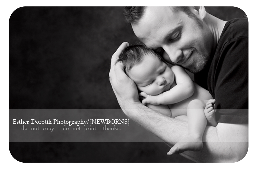 black-and-white-photograph-of-newborn-boy-in-his-daddy