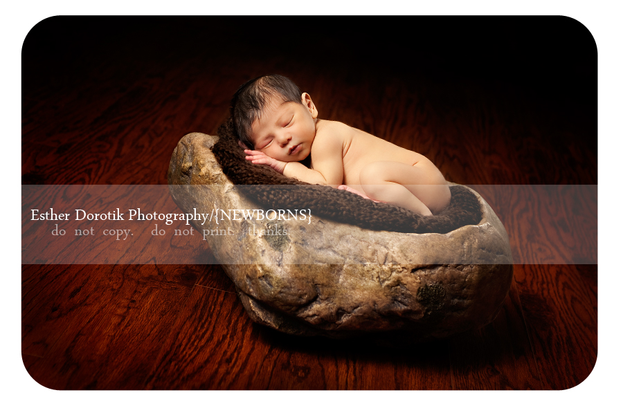 Frisco-newborn-photographer-with-baby-boy-laying-on-blanket-on-rock