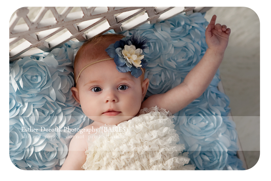 beautiful-baby-girl-with-blue-headband-and-blue-rosette-fabric