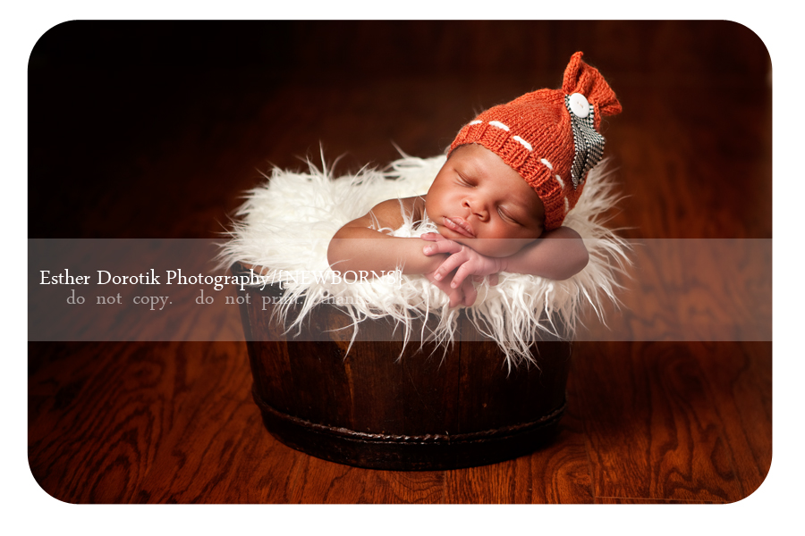picture-of-Dallas-newborn-boy-in-brown-bucket-with-orange-hat