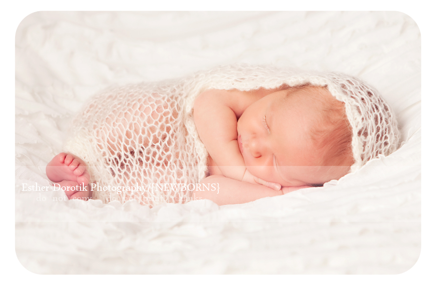 newborn-baby-wrapped-in-lace-knit-photographed-by-Denton-photographer