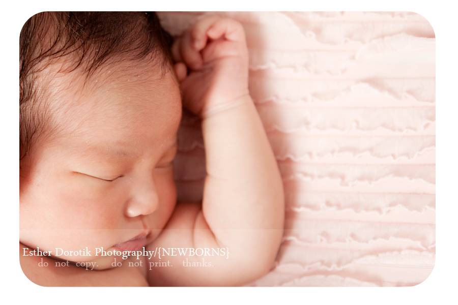 unique-newborn-photograph-of-baby-face-and-hand-by-flower-mound-photographer