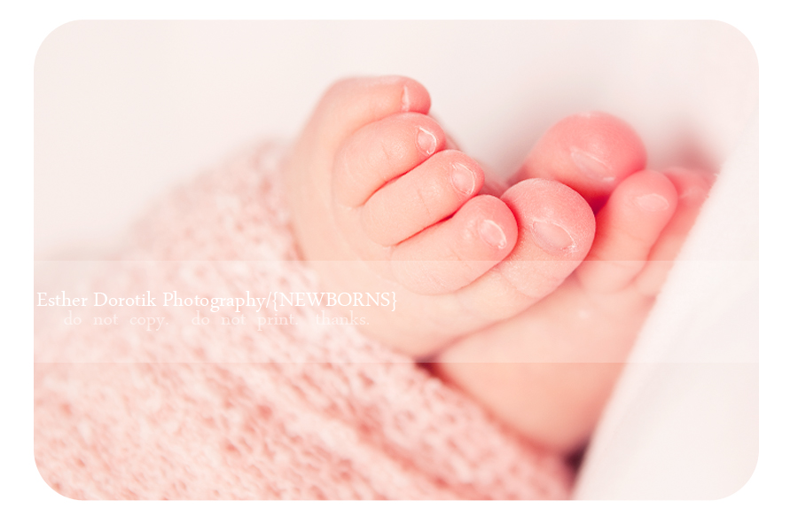 close-up-photograph-of-tiny-newborn-toes
