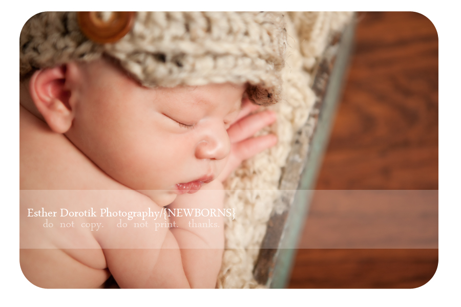 close-up-profile-picture-of-new-baby-with-newsboy-hat-photographed-by-Dallas-Photographer