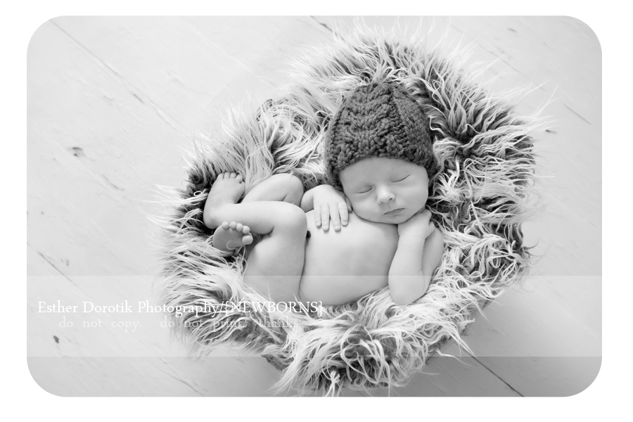 black-and-white-of-newborn-baby-boy-laying-in-basket-by-Dallas-photographer