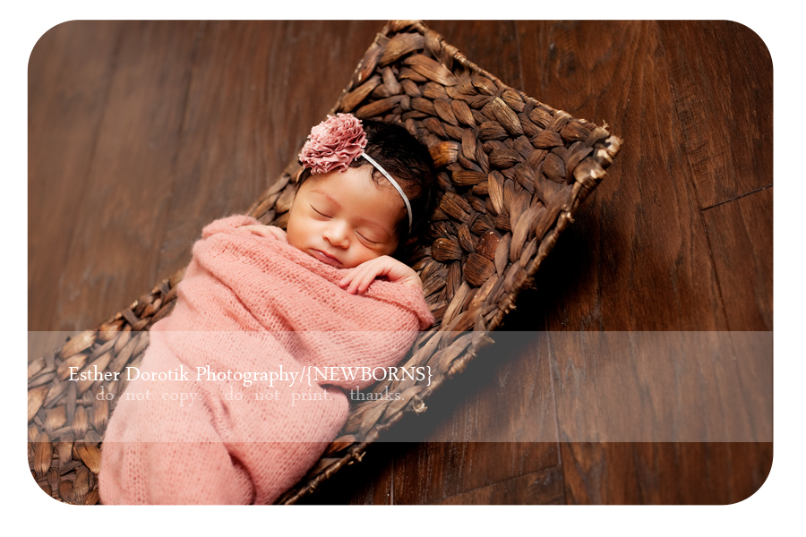 newborn-baby-wrapped-in-knit-laying-in-basket-by-Dallas-photographer