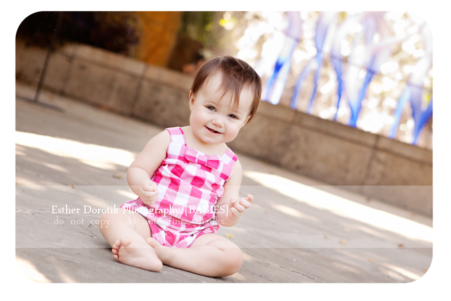 laughing-one-year-old-photography-session-at-wall-of-water-Dallas-Arboretum