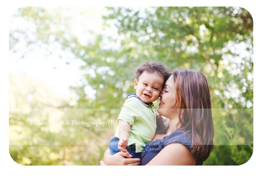 9-month-old-photography-in-a-field-with-mommy-smiling-as-he-is-snuggled-by-Dallas-photographer