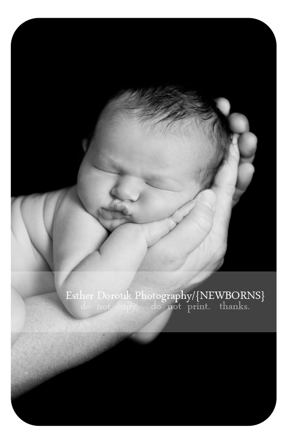 close-up-black-and-white-picture-of-newborn-infant-laying-in-hands-by-Fort-worth-newborn-photographer
