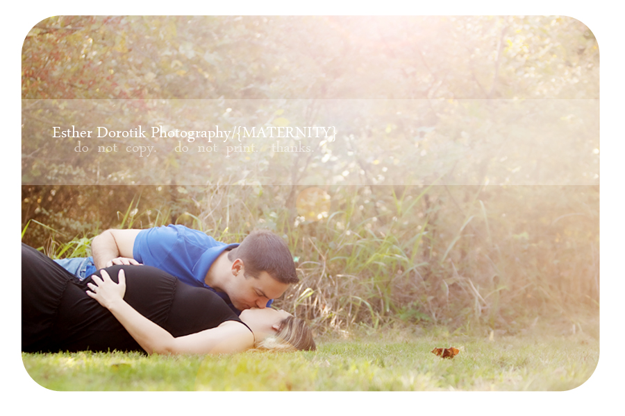 relationship-photography-of-pregnant-couple-laying-in-field-with-sunflare-by-maternity-photographer