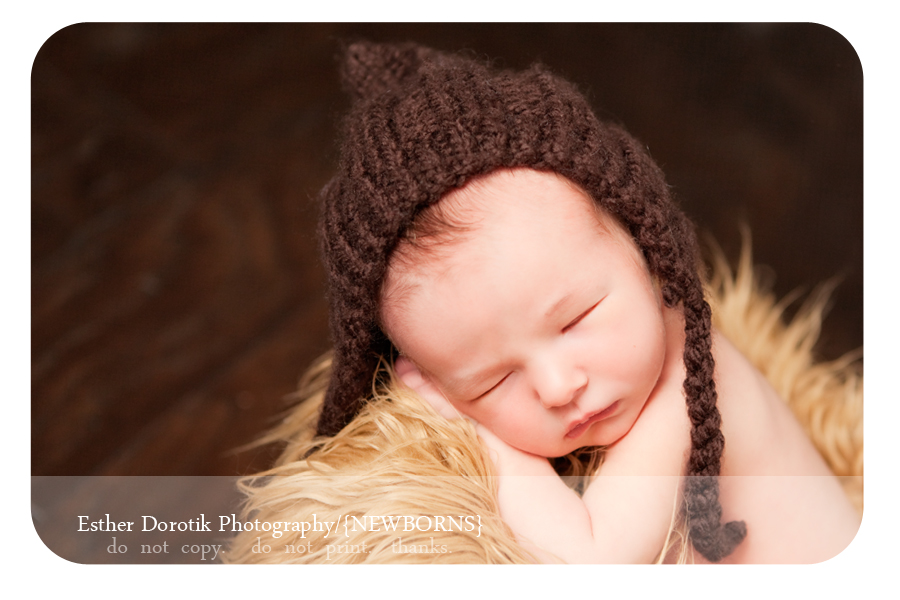 unique-Dallas-newborn-and-family-photographer-captures-infant-boy-in-caramel-fur-with-knit-hat