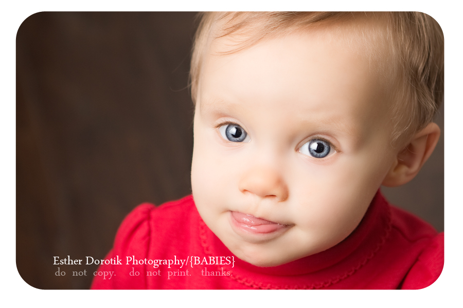 Frisco-newborn- and-baby-photographer-captures-9-month-old-little-girl-sticking-her-tongue-out