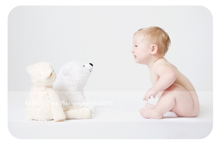naked-one-year-old-baby-session-smiling-with-stuffed-animals