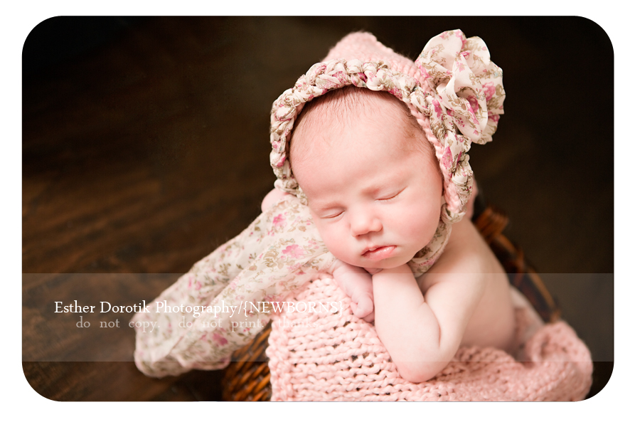 newborn-infant-laying-in-basket-with-knit-pink-headband-captured-by-Frisco-newborn-photographer