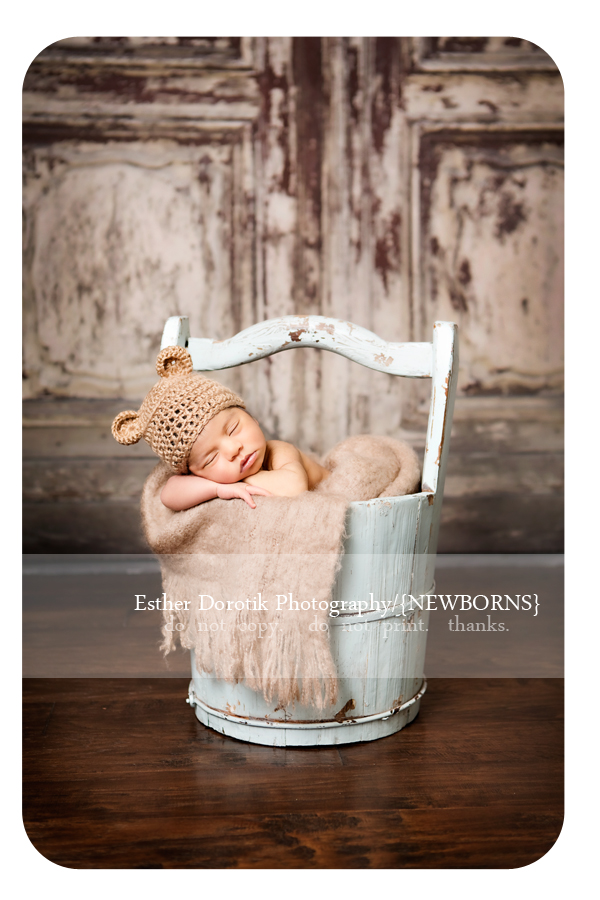 Irving-photographer-captures-new-born-posed-in-blue-bucket-in-front-of-distressed-door