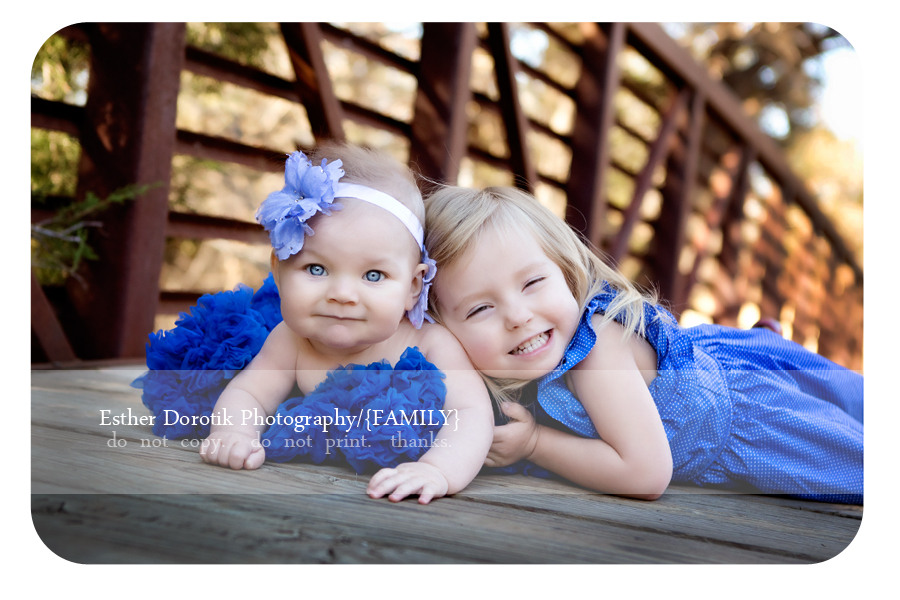 sibling-girls-photographed-by-Dallas-family-photographer-outdoors-in-Flower-Mound-bridge