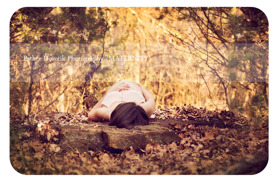 Dallas-lifestyle-photography-of-expecting-mommy-captured-laying-on-rock-outdoors
