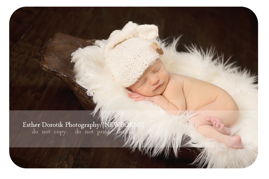 Dallas-newborn-baby-photographer-captures-baby-boy-in-cream-fur-and-knit-hat