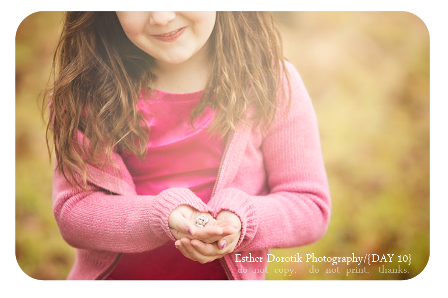 bright-sunflare-image-of-little-girl-holding-shells