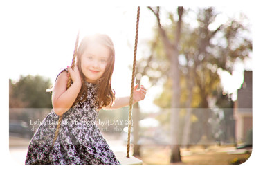 Dallas-newborn-photographer-captures-little-girl-sitting-on-swing-with-sunflare