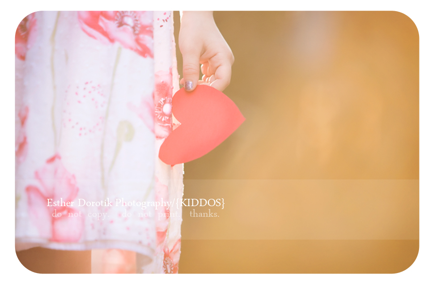 lifestyle-photograph-of-little-girl-holding-heart-for-Valentine