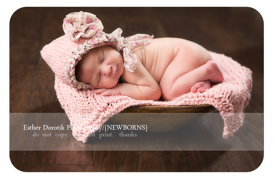 Flower-Mound-based-newborn-photographer-captures-little-baby-girl-in-basket-with-bonnet-on