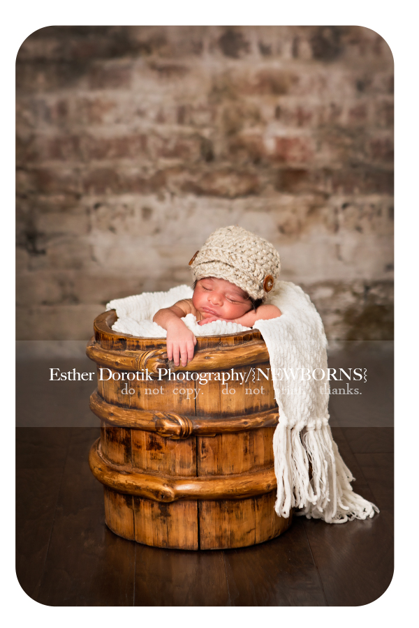 infant-newborn-photography-of-baby-laying-in-knotty-basket-taken-by-Grapevine-newborn-photographer