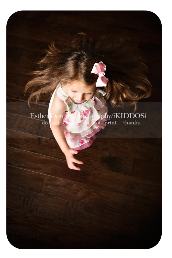 fun-child-photography-in-studio-of-little-girl-twirling-around