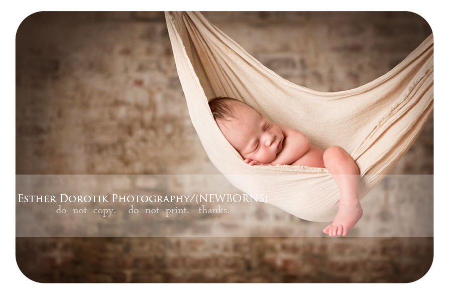 newborn-baby-hangning-in-a-sling-hammock-style-posing-by-Dallas-newborn-photographer