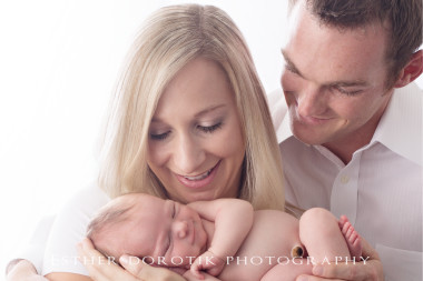 smiling-newborn-baby-with-family-and-newborn-taco-pose-by-Dallas-newborn-photographer