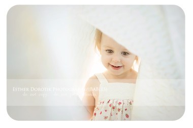 bright-baby-photo-of-little-girl-playing-in-sheet-by-Dallas-baby-child-photographer
