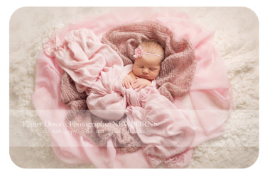 newborn-baby-girl-wrapped-in-knit-laying-on-blanket-by-Dallas-Fort-Worth-newborn-photographer