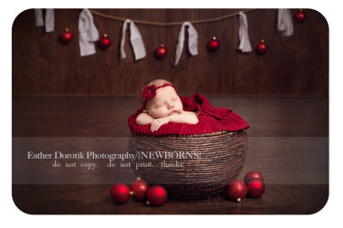 newborn-baby-girl-with-Christmas-balls-hanging-in-basket-by-Dallas-baby-photographer