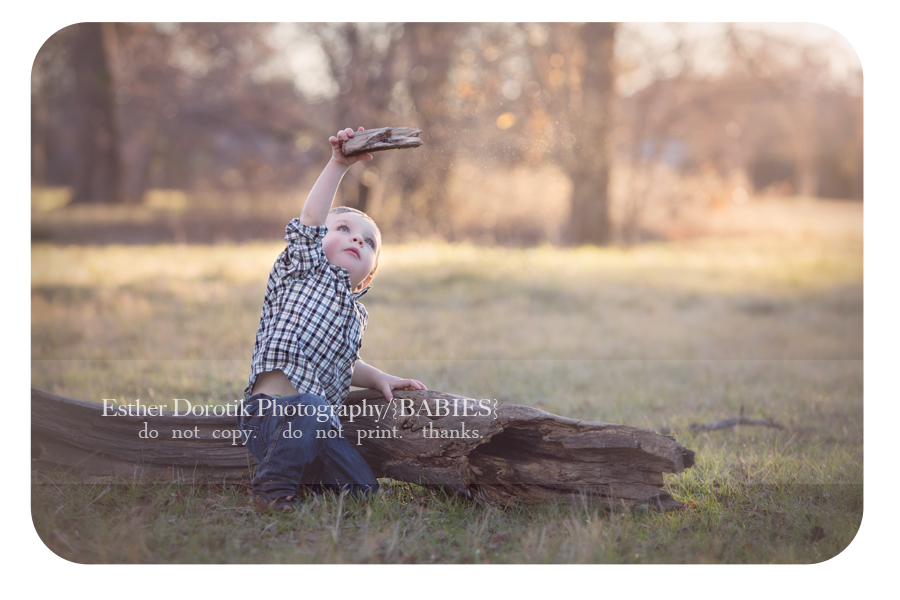 18-month-old-photo-of-little-boy-playing-with-wood-airplane-at-sunset-by-Flower-Mound-baby-photographer