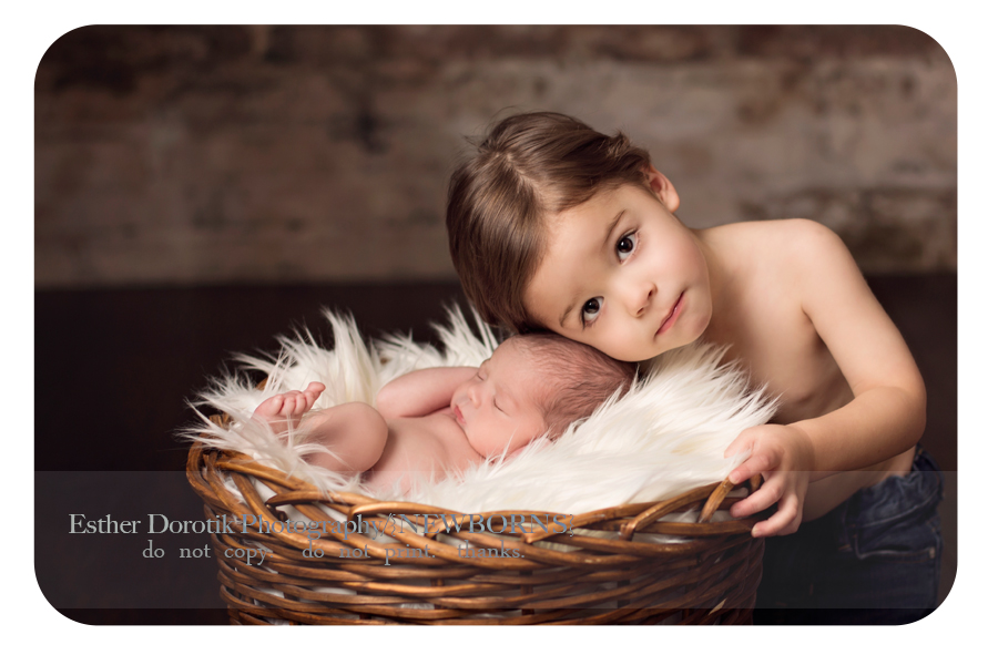 Dallas-newborn-photo-of-newborn-baby-in-basket-with-shirtless-brother-laying-next-to-him