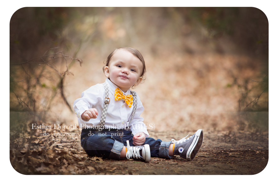 picture-of-one-year-old-baby-boy-wearing-a-tie-sitting-on-rock-in-trees-by-Dallas-baby-photographer