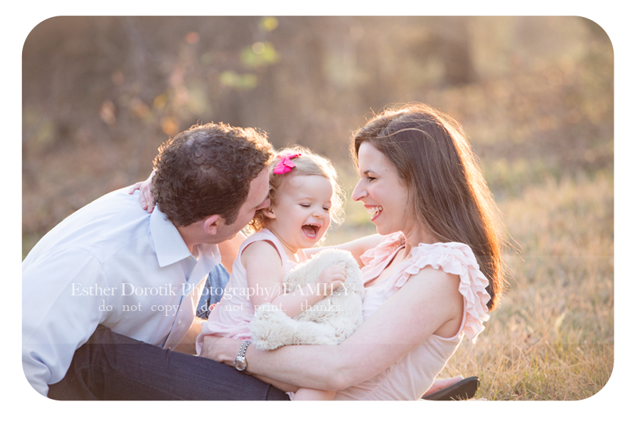 lifestyle-picture-of-family-laughing-in-field-at-sunset-by-Dallas-famiy-photographer
