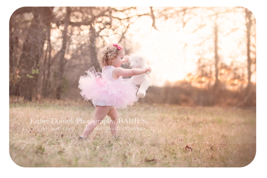 photo-of-2-year-old-baby-girl-dancing-in-tutu-with-bear-at-sunset-by-Frisco-baby-photographer