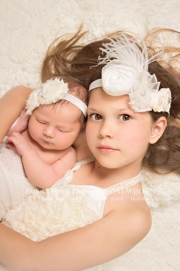 8-year-old-holding-her-newborn-sister-photo-by-Dallas-family-photographer