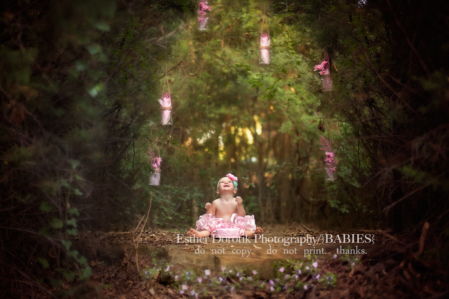 cake-smash-photography-session-of-one-year-old-girl-in-woods-by-Colleyville-baby-photographer