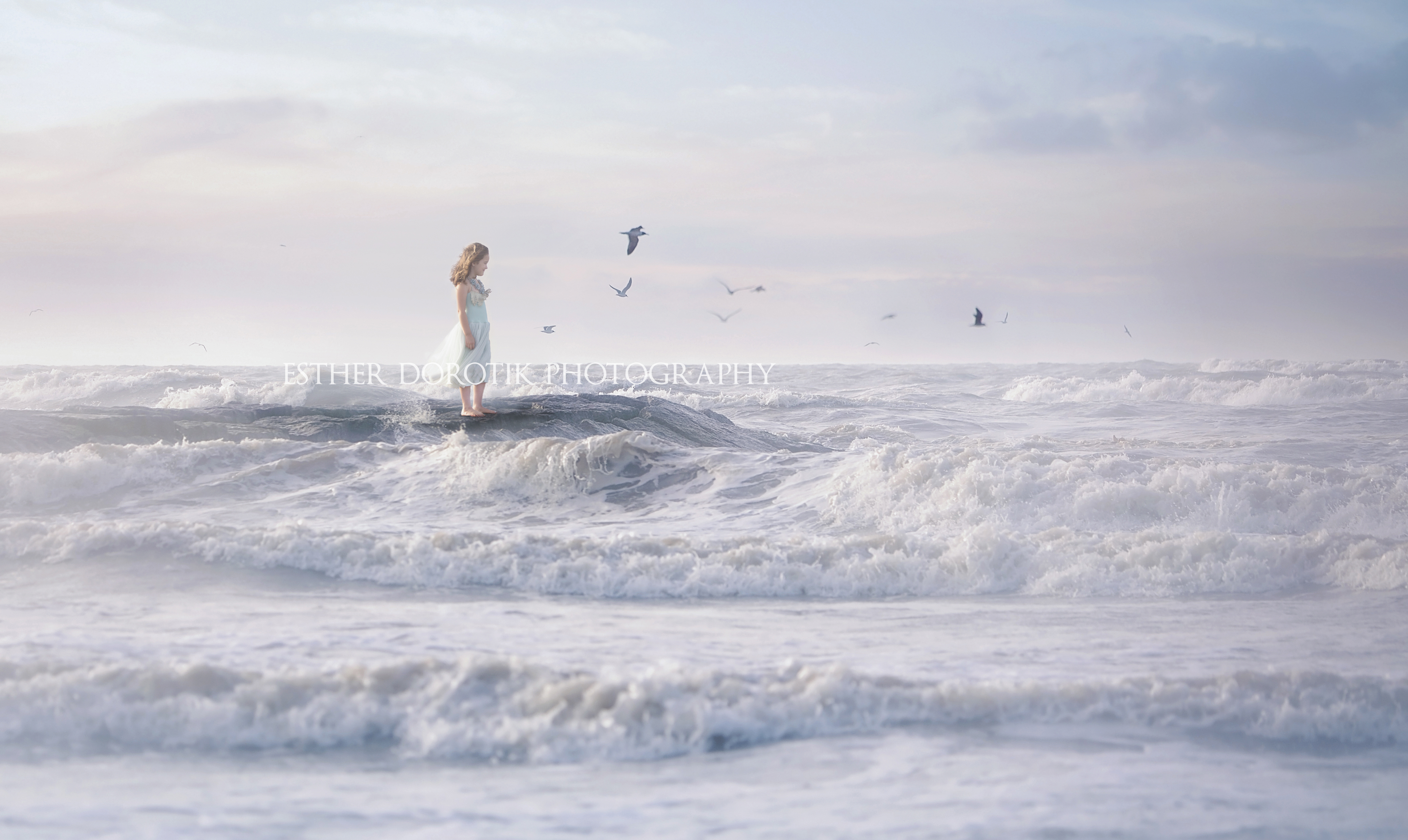 6-year-old-girl-standing-on-pier-at-beach-by-Dallas-Fort-Worth-Children-photographer
