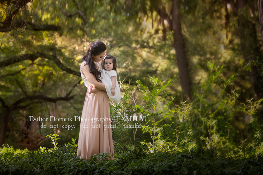 picture-of-mommy-holding-one-year-old-girl-in-forest-by-Highland-Park-family-photographer