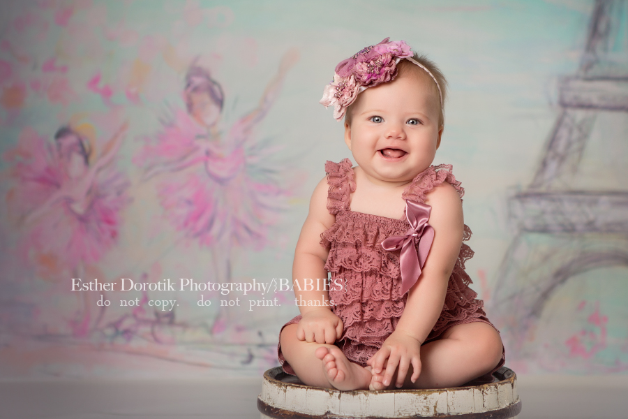 picture-of-6-month-old-in-pink-ruffles-with-ballerina-backdrop-by-Frisco-baby-photographer